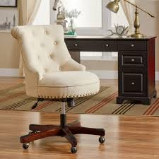 adorned with elegant nailhead trim and featuring glamorous tufted upholstery this chic rolling chair is perfect pulled up to your writing desk or bring a