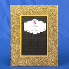 our frame is made from glass and features a wide beveled border with a gold glitter finish it can be used horizontally or vertically and holds a standard 4