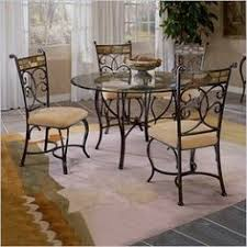 hilale pompei dining set with gl top black gold slate mosaic decorative scrollwork and distinctive mosaic designs distinguish the pompei dining set