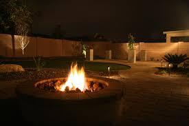 custom landscape lighting ideas. Fire In The Night: Phoenix Outdoor Living Custom Landscape Lighting Ideas