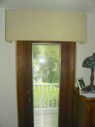 Custom cornices creatively conceal. » Susan's Designs & To help with the heating cost the quilted roller shades were used on the  door wall as well. Adamdwight.com