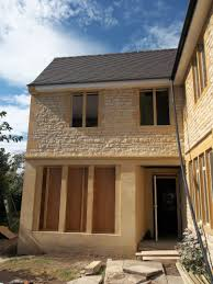 clent farmhouse a new skin has been built around the old house with new bath stone window heads cills and also a front portico that was all hand carved build home cotswold