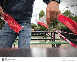 a man tears up a barrier tape in a beer
