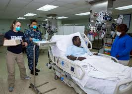 u s department of defense photo essay a u s navy hospital corpsman and a volunteer project hope look after a patient on