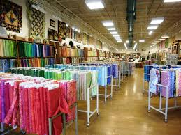 A Passionate Quilter: Maui Quilt Shops & After seeing how much fabric this shop had, I sent my husband off on his  own to explore the mall. Adamdwight.com