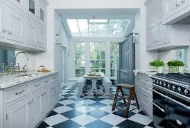 classic checkerboard marble tiles are beautifully updated in the glamorous kitchen