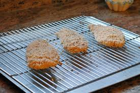 cookie sheet with cooling rack baking oven fried chicken on a cooling rack placed on top of a