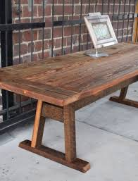 rustic farm table constructed of salvaged heart pine with medium finish custom wood creations