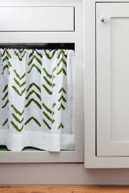 a diy stenciled laundry room under the sink curtain using the kuba chevron stencil in green