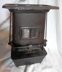 stove mica. antique cast iron sad oil heater, mica window, union stove gardner ma 1890s