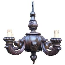 unique black forest carved wood chandelier with five owl sculptures for