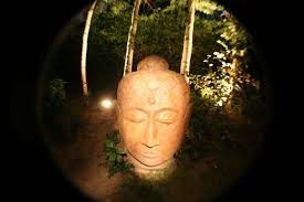 picture of giant concrete buddha head garden sculpture