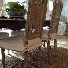 antique caned back dining chairs wearing their new whitedenim seat slipcovers with mini running pleats and ties