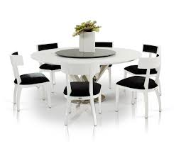 modern round dining room table with 8 black and white chairs set