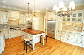 kitchens with light wood floors this white kitchen cabinets with light hardwood floors