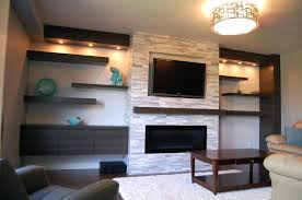 gas fireplace wall unit family room idea stacked stone fireplace wall with built ins and floating gray gas fireplace wall unit bookcase tv