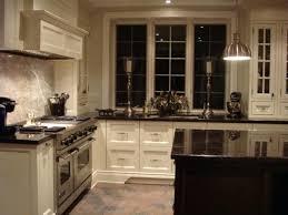 white kitchen cabinets with dark granite countertops off white kitchen cabinets granite countertops