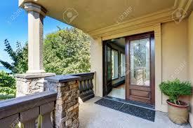 open house door. Luxury House Exterior. Entrance Column Porch With Railings And Rug Open Front Door. Northwest Door F