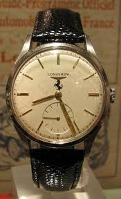 2 ferrari stamped longines watches that belonged to sergio the first one is a classic 1960 watch a small seconds sub dial for that old school mad men flair