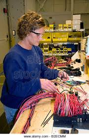 wiring harness stock photos wiring harness stock images alamy female worker wiring harness assembly at spartan motors truck chassis manufacturing in charlotte michigan