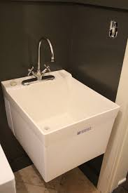 finding a wall mount utility tub with the faucet on the sink instead of mounted to the wall was a challenge see all the open floor space