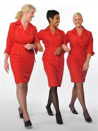flight attendants of delta air lines looks stunning in red wrap uniforms designed by richard tyler bilingual flight attendant jobs