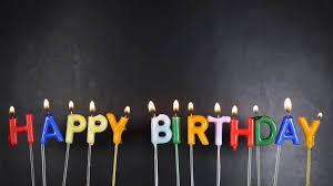 happy birthday candles on black background stock footage blocks