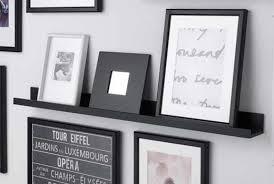 multiple picture frames. IKEA MOSSLANDA Black Picture Ledge With Multiple Frames On Top.