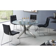 round glass dining table with four black chairs