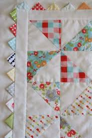 Incorporate triangles into the quilt binding border! Would be cute ... & Pinwheel Quilt | Ten Cow Chick Adamdwight.com