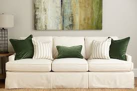 throw pillows in emerald green and stripe