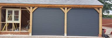 nice little project fitting two roller doors on a barn in anthracite