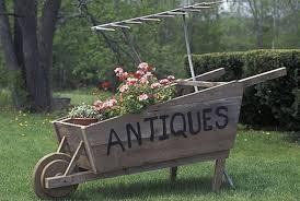 old wood wheelbarrow planter