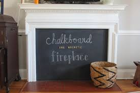 this fantastic idea takes the worry out of your fireplace while turning it into a magnetic chalkboard activity center for your child a win win