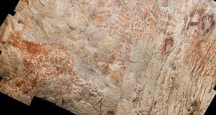 cave painting of red animal in borneo