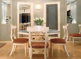 blue fabric seat covers teal wall color formal dining room chairs dark brown finish solid wood long table presenting two white wooden legs and high back