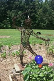 metal scarecrow with light sensors keep the squirrels away and make a great natural squirrel repellent