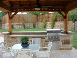 modern exterior ceiling fan also backyard with stylish summer kitchen and wrought iron dining chairs design