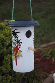 Outdoor classroom idea: Birdhouse made from pvc pipe and a clay pot bottom.