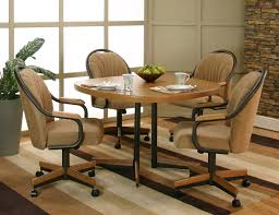 casual sunset oak finished dining table with 4 chenille upholstered tilt swivel arm chairs