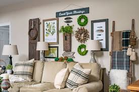 rustic gallery wall above the sofa