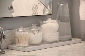 Bathroom counter decorating ideas Guest Bathroom The Right Side Of My Bathroom Countertop Has Been Adorned With Container Store Acrylic Canisters To Redefining Domestics Bathroom Countertop Decor Redefining Domestics