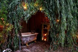 natural canopy offers the perfect spot for an outdoor bath from shannon malone