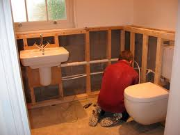 substantial timber framing to provide false walls where cisterns soil pipes and water pipes could be concealed and provide a cleaner look to the bathrooms