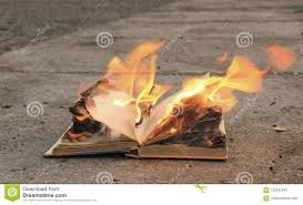 book with burning pages on a concrete surface stock photo image of burning