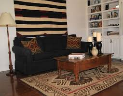 living room cozy rug with rustic coffee table and black loveseat plus decorative cushions target bookshelves striped walls area rugs clearance patio