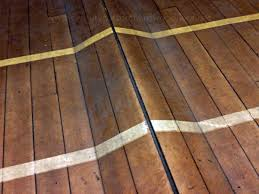 can buckled hardwood floors be repaired