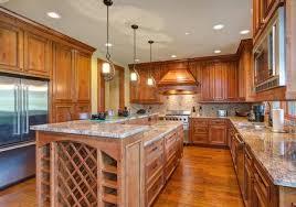 Gourmet Kitchen Boasts A Bar Style Kitchen Island With Builtin Fascinating Gourmet Kitchen Design Style