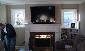 mounting a tv over fireplace lcd brick install hide wires on rock