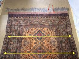 clues of tension change and potential shrinking risk arrows show problems in weft and